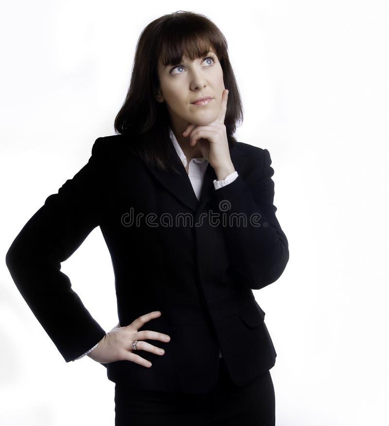 Femme d'affaires dans la recherche pensante de procès image libre de droits