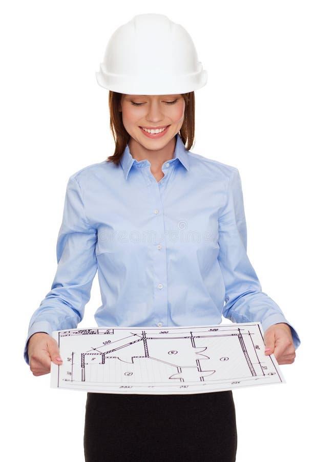 Femme d'affaires dans le casque regardant le modèle images stock