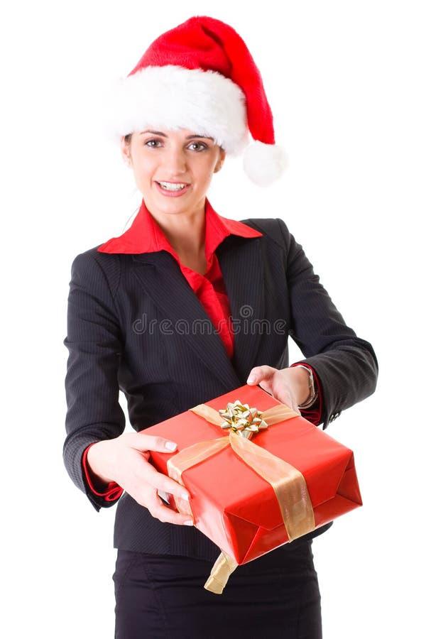 Femme d'affaires dans le chapeau et avec le cadeau rouge, d'isolement photos libres de droits