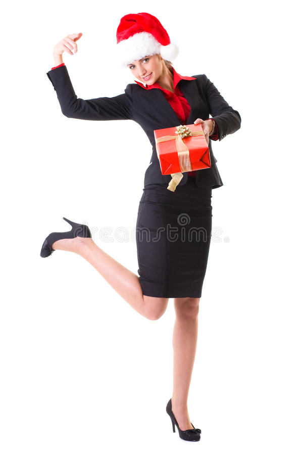 Femme d'affaires dans le chapeau et avec le cadeau rouge, d'isolement image stock