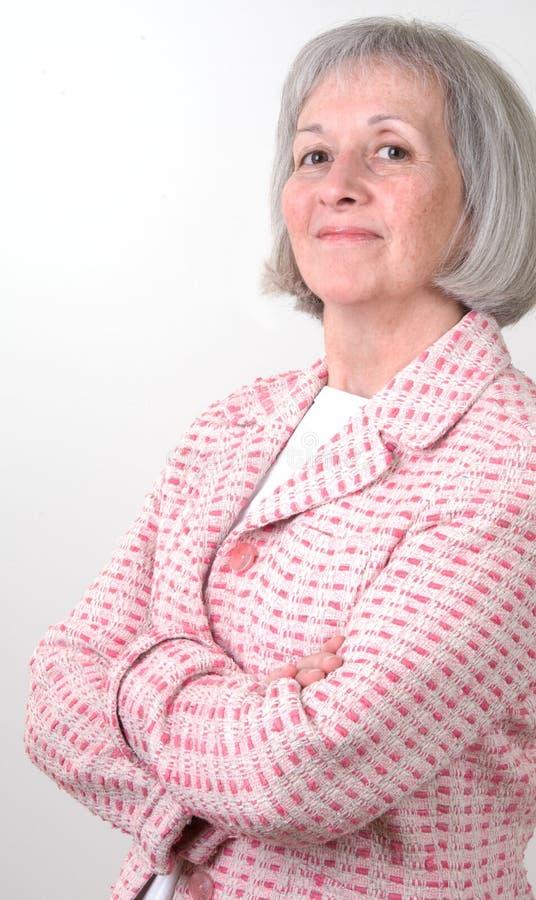 Femme d'affaires dans le rose image stock