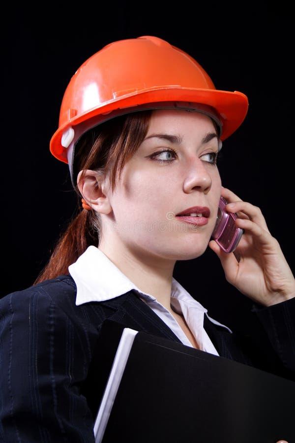 Femme d'affaires dans un casque photographie stock libre de droits