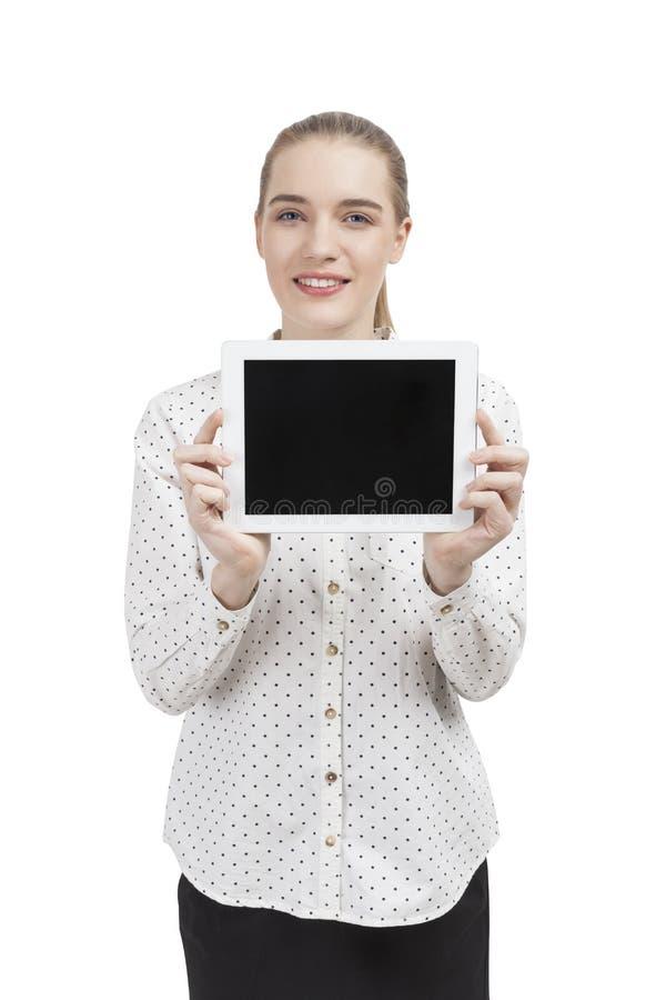 Femme d'affaires dans une chemise de polka avec un comprimé image libre de droits