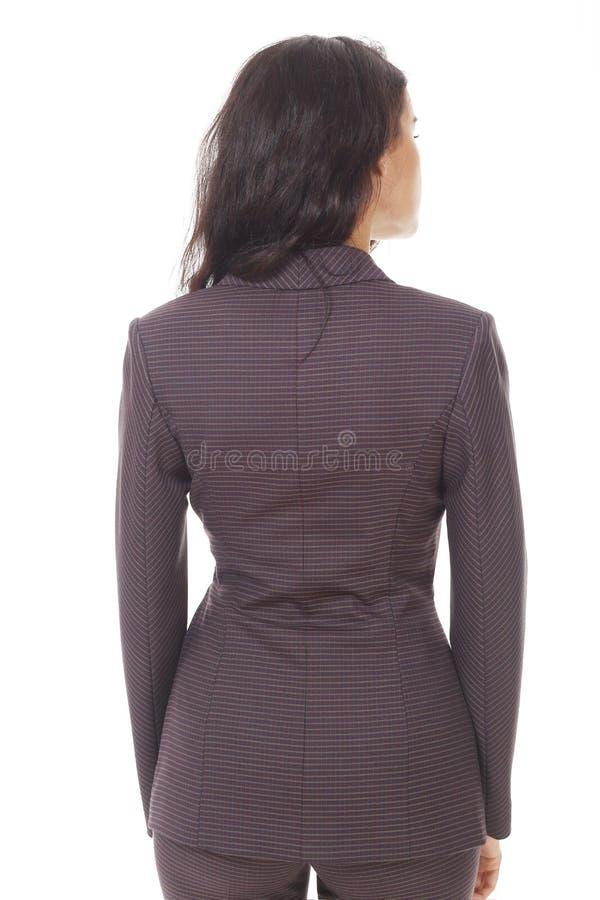 Femme d'affaires de brune dans la fin occasionnelle de veste vers le haut de la photo d'isolement sur le blanc photo stock