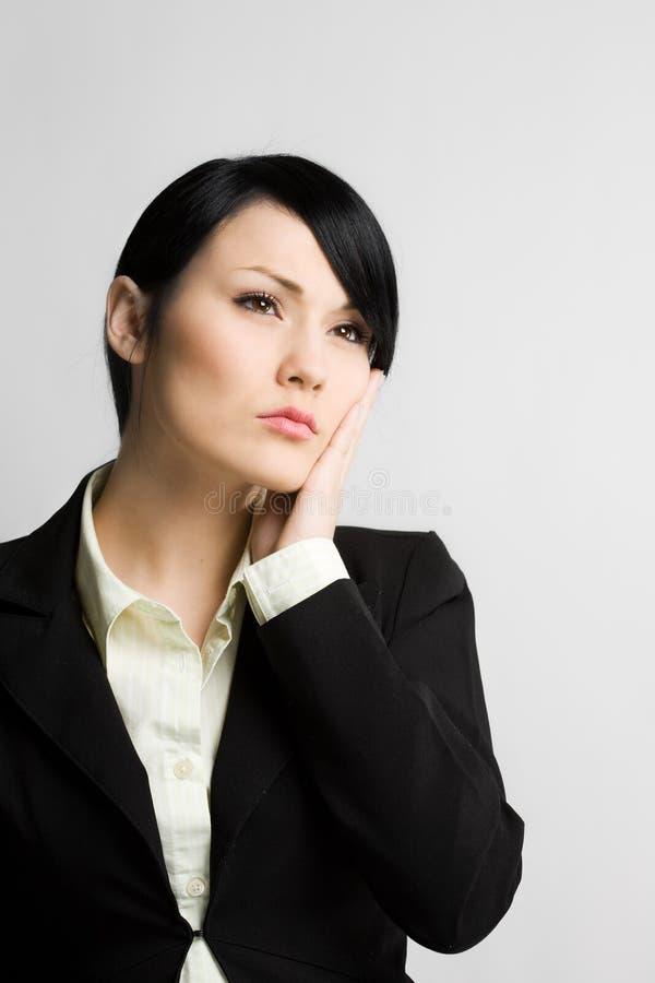 Femme d'affaires de rêverie images stock