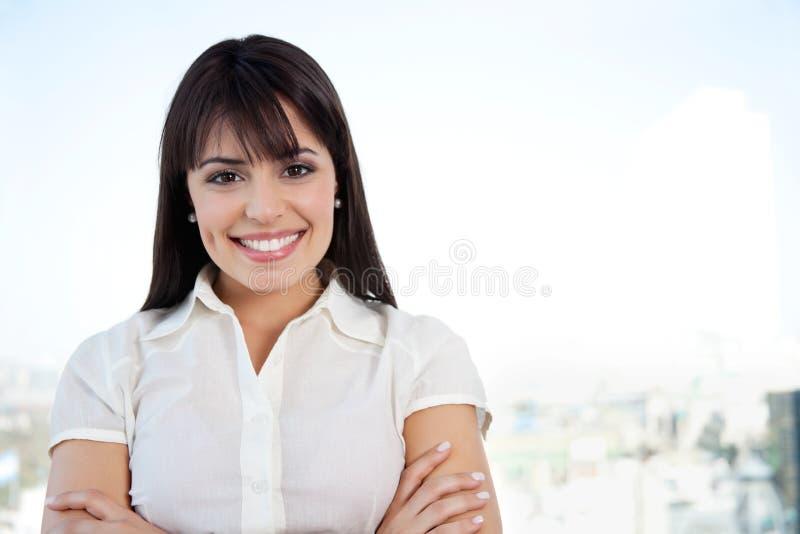 Femme d'affaires de sourire attirante image libre de droits