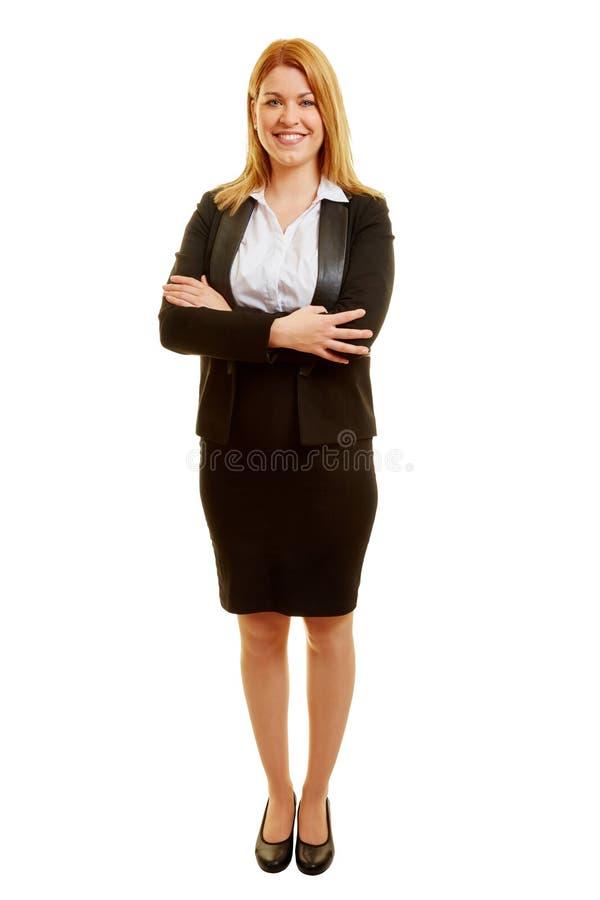 Femme d'affaires de sourire avec des bras croisés images libres de droits