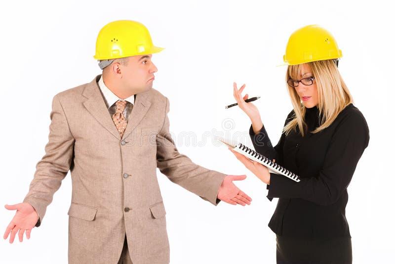 Femme d'affaires et architecte fâchés image libre de droits