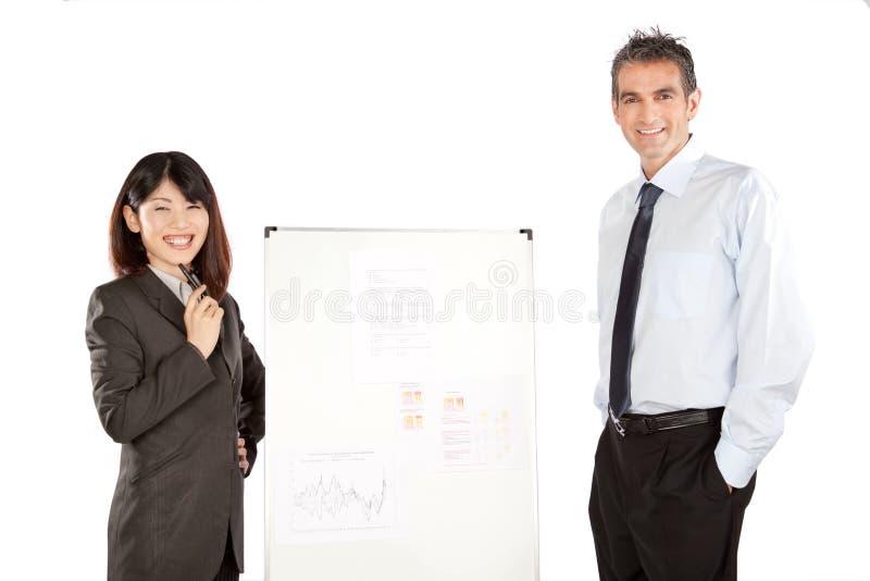 Femme d'affaires et homme d'affaires Giving Presentation photos stock
