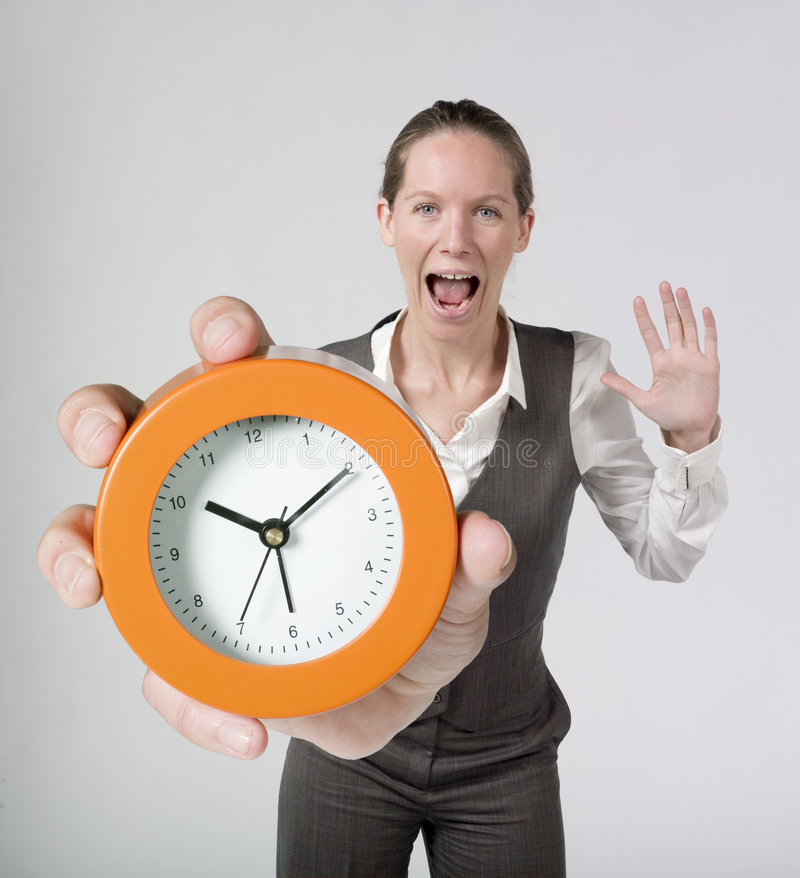 Femme d'affaires et horloge d'alarme Excited photo stock
