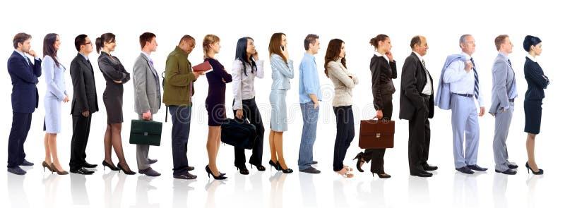 Femme d'affaires et son équipe au-dessus d'un fond blanc photographie stock libre de droits