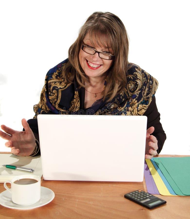 Femme d'affaires exaltée photographie stock