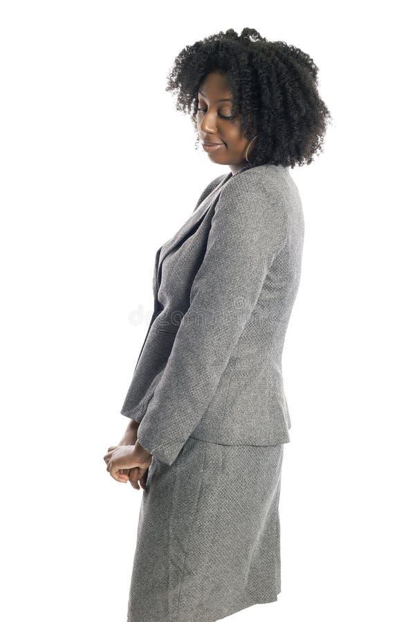 Femme d'affaires féminine noire Looking Shy photos stock