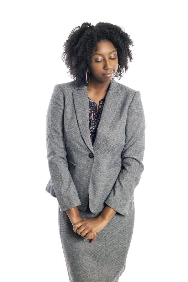 Femme d'affaires féminine noire Looking Shy image stock