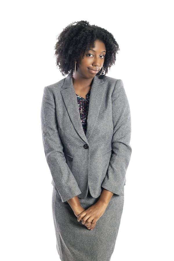 Femme d'affaires féminine noire Looking Shy photographie stock libre de droits