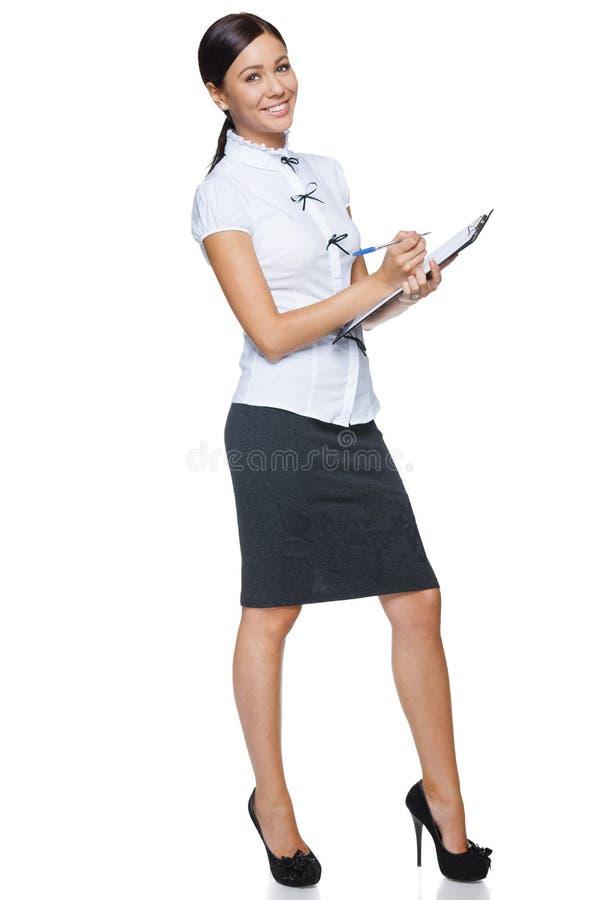 Femme d'affaires faisant des notes photos stock
