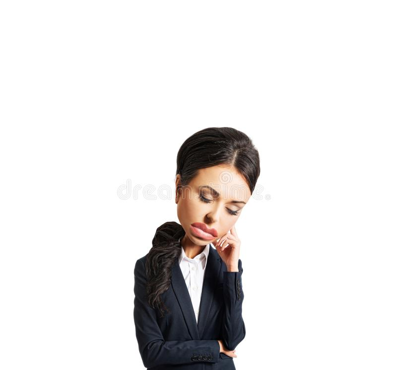 Femme d'affaires fatiguée en raison des problèmes tenant sa tête photo stock