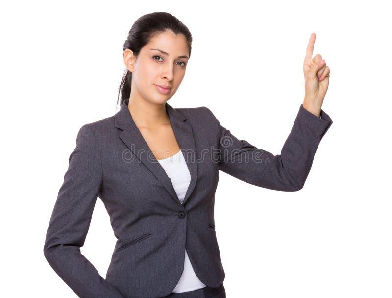 Femme d'affaires indienne montrant le point de doigt  photos stock