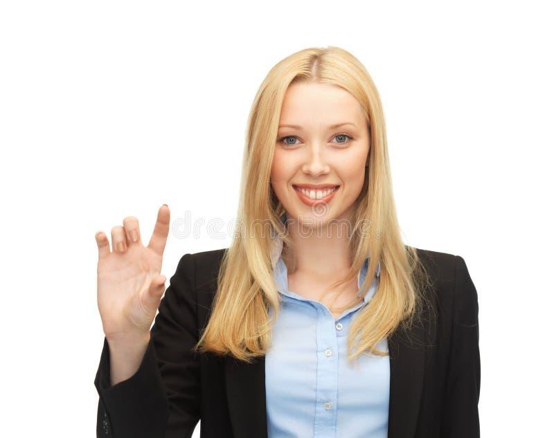 Femme d'affaires jugeant quelque chose imaginaire photos stock