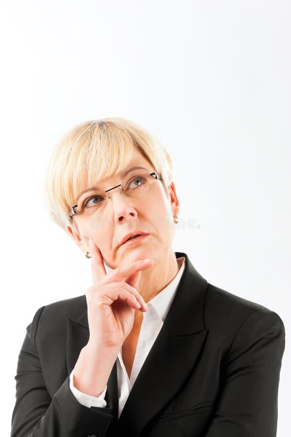 Femme d'affaires mûre réfléchie images libres de droits