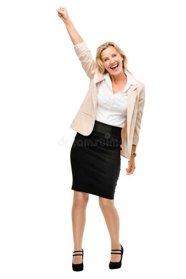 Femme d'affaires mûres célébrant le sourire de succès d'isolement sur le wh image stock