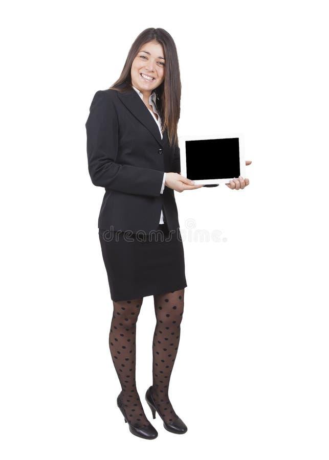 Femme d'affaires montrant le comprimé image stock
