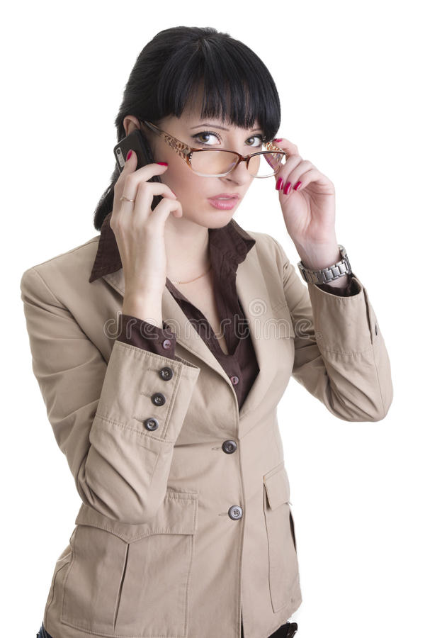 Femme d'affaires parlant au-dessus du téléphone portable photographie stock