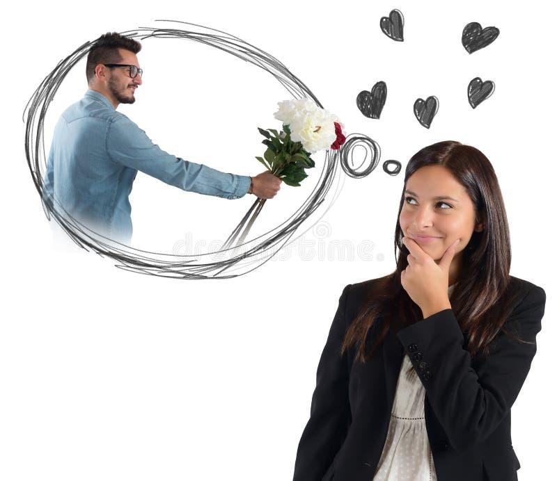 Femme d'affaires pensant à l'ami photographie stock libre de droits