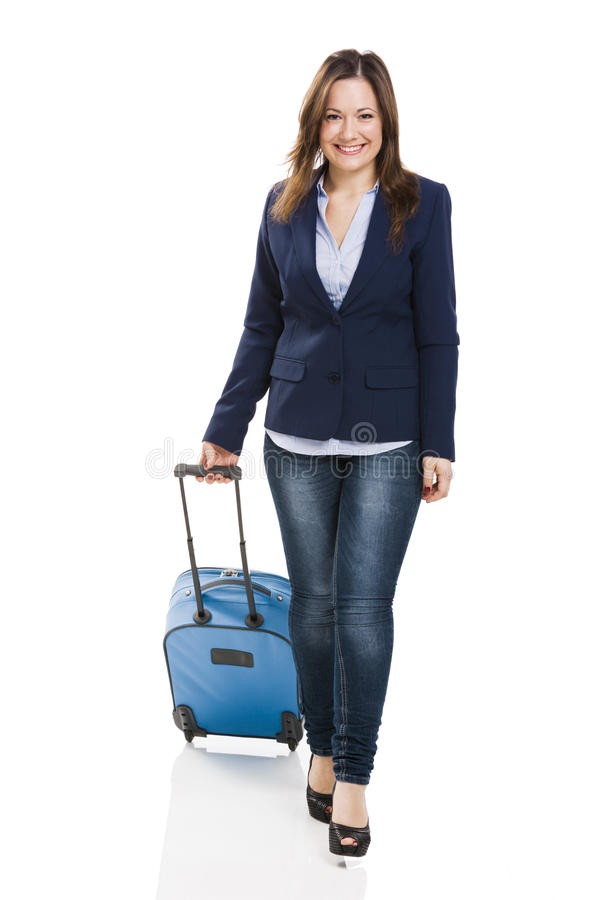 Femme d'affaires portant une valise photo libre de droits