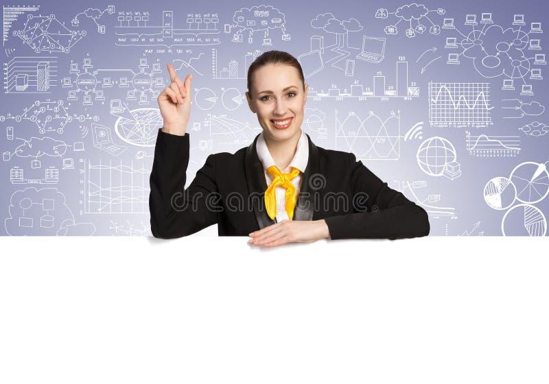 Femme d'affaires présent quelque chose photographie stock