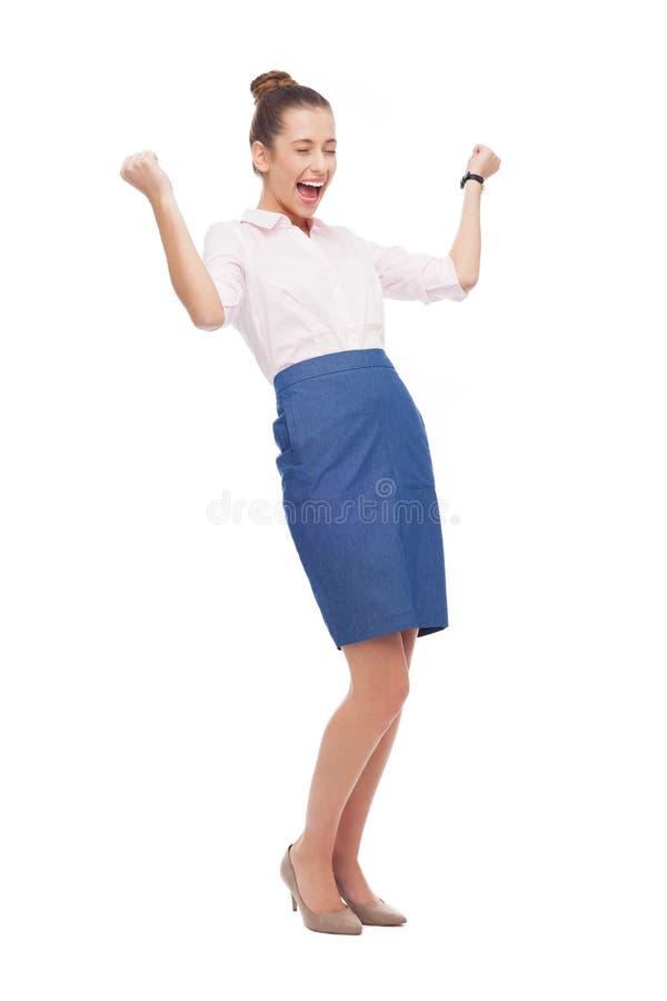 Femme d affaires réussie avec les poings serrés