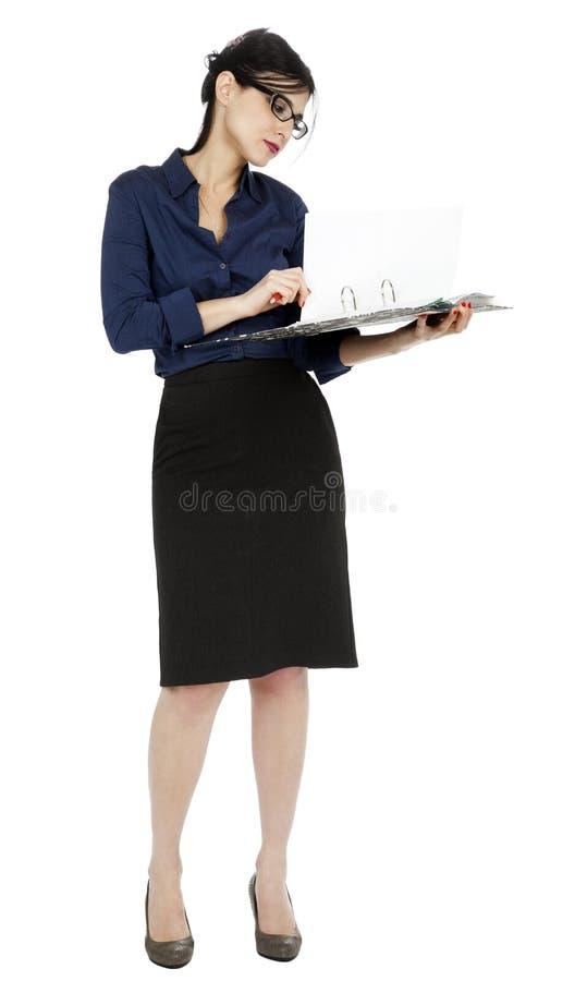 Femme d'affaires renversant la page de document photos stock