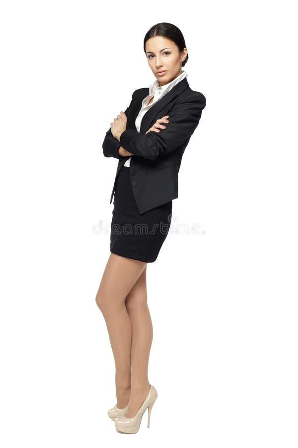 Femme d'affaires restant avec les mains pliées image libre de droits