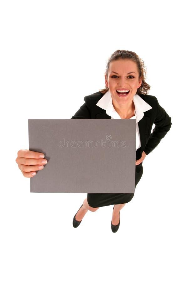 Femme d'affaires retenant l'affiche blanc photographie stock