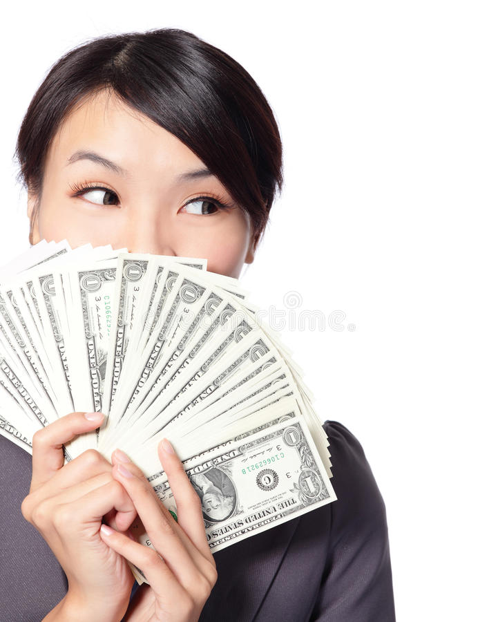 Femme d'affaires retenant l'argent photo stock