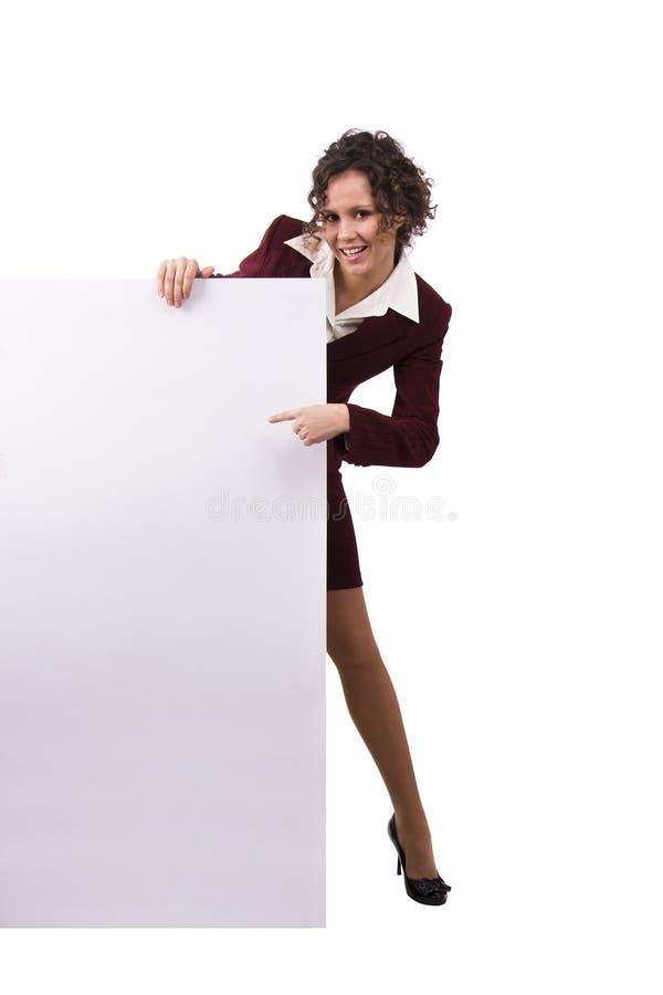 Femme d'affaires retenant un panneau-réclame. photo stock