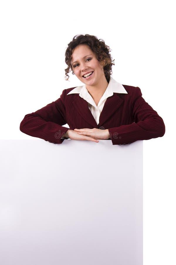 Femme d'affaires retenant un panneau-réclame. photos libres de droits