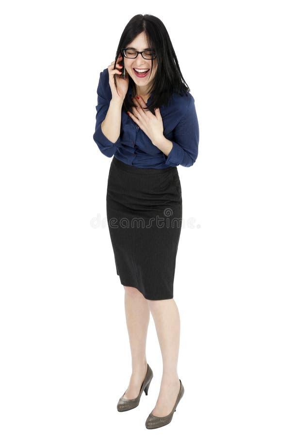 Femme d'affaires riant au téléphone photographie stock libre de droits