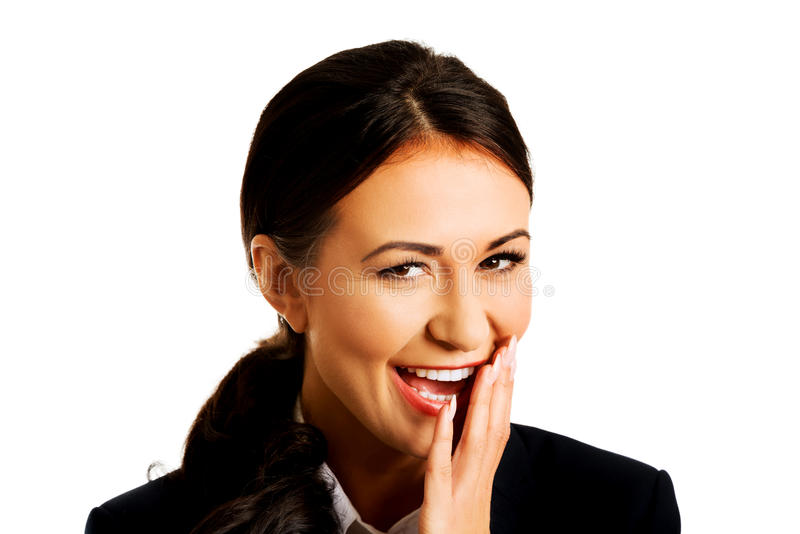 Femme d'affaires riant fort photographie stock
