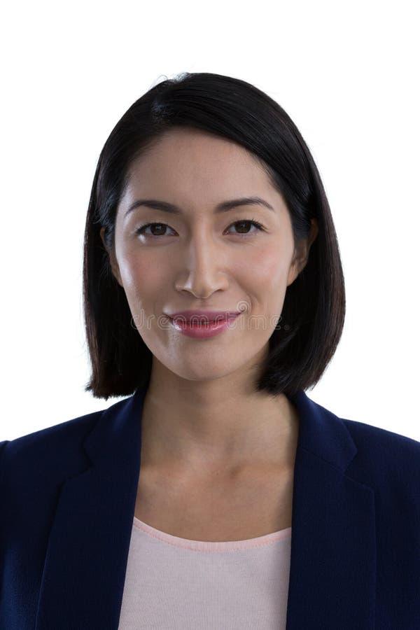 Femme d'affaires sûre sur le fond blanc image stock