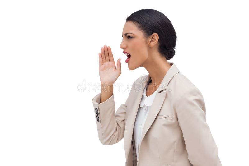 Femme d'affaires sûre réclamant quelqu'un photographie stock