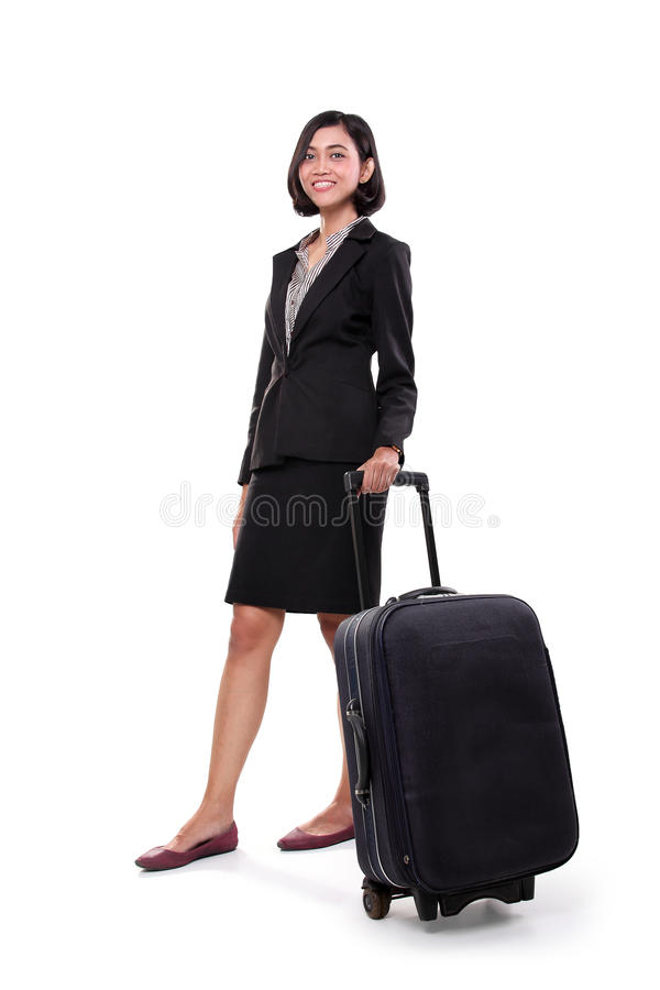 Femme d'affaires se tenant avec sa valise, plein corps photo stock
