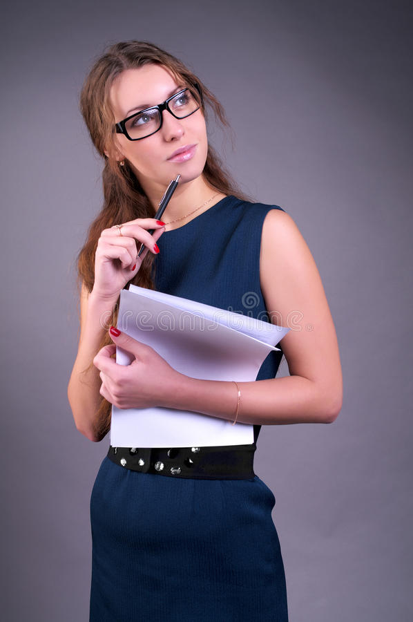 Femme d'affaires songeuse images stock