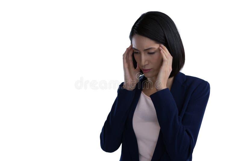 Femme d'affaires Suffering From Headache image libre de droits