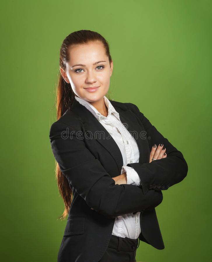 Femme d'affaires sur le fond vert photographie stock
