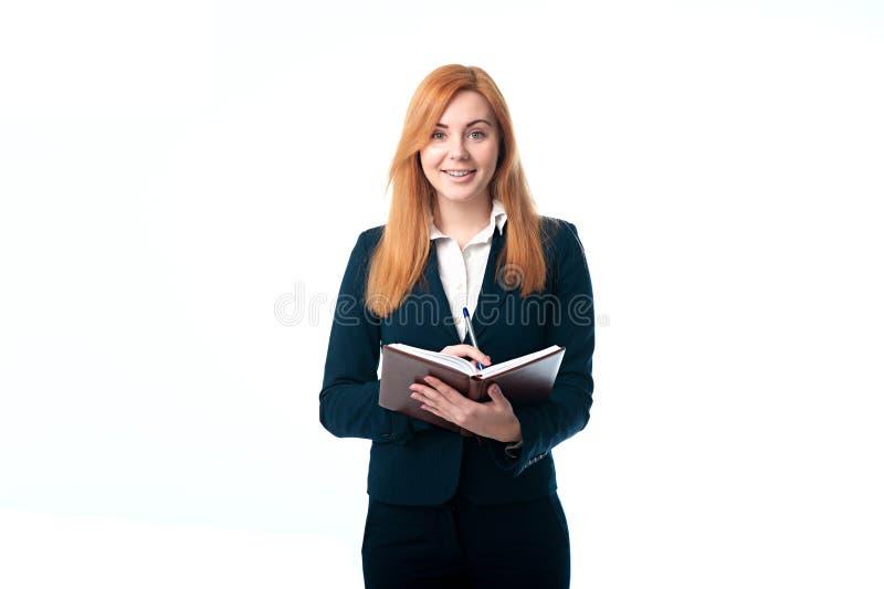 Femme d'affaires tenant un journal intime images stock