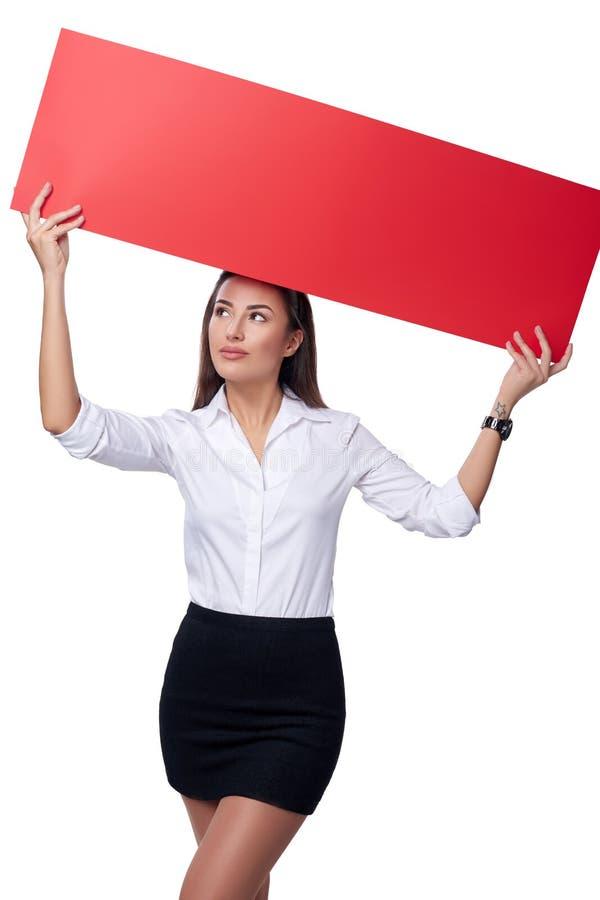 Femme d'affaires tenant une bannière images stock
