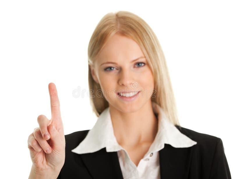 Femme d'affaires touchant l'écran avec son doigt photos libres de droits