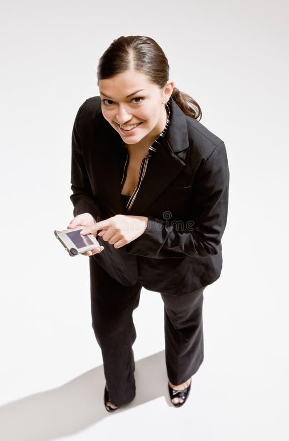 Femme d'affaires utilisant l'organisateur électronique images libres de droits