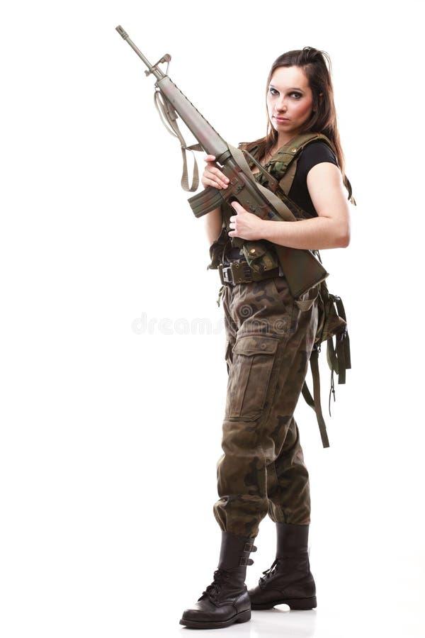 Femme d'armée avec le canon - femme avec du plastique de fusil photos stock